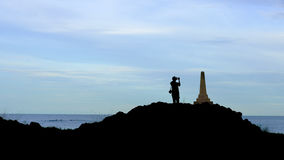 Sea and monuments. The man is taking pictures Sea and monuments, silhouette background , With space to write at left royalty free stock images