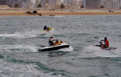 Sea motor boats dancing in the water. Sea motor in front of Sharjah at Mamzar Beach Stock Photography