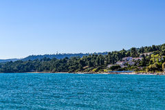 Sea and mountain covered with green plants. Greece. Kassandra. Halkidiki Royalty Free Stock Image