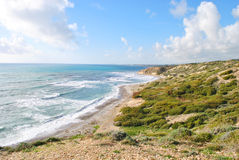 Sea with mountain. A landscape shot of an amazing wavy sea connecting with a green mountain . Cyprus Royalty Free Stock Photos