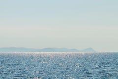 Sea and mountain range. Summer seascape horizon. Water surface stock photography