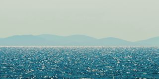 Sea and mountain range. Summer seascape horizon. Nature Background royalty free stock image