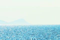 Sea and mountain range. Summer seascape horizon. Summer royalty free stock image