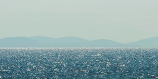 Sea and mountain range. Summer seascape horizon. Background stock images