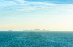 Sea and mountain. In sunrise background Stock Photo