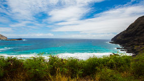Sea and Mountain. The sea and mountain under blue sky and cloud,Hawaii royalty free stock photo