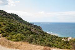 The sea in a mountainous area with trees in the afternoon stock images