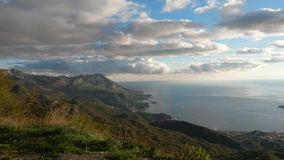 Sea mountains and clouds. Landscape of sea and mountains on a cloudy day Stock Photography