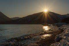 Sea mountains ice sun Stock Image