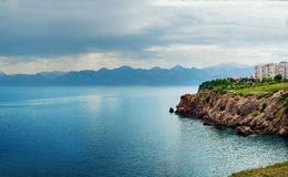 Mediterranean sea and mountains landscape of Antalya. Panoramic view of Mediterranean sea rocky coast and mountains landscape of Antalya city in Turkey Royalty Free Stock Photo