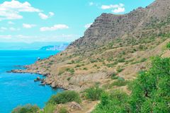 Sea and Mountains landscape at Cape Meganom, the east coast of the peninsula of Crimea. Beautiful nature, Colorful background. royalty free stock photography