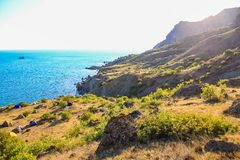 Sea and Mountains landscape at Cape Meganom, the east coast of the peninsula of Crimea. Beautiful nature, Colorful background. stock images