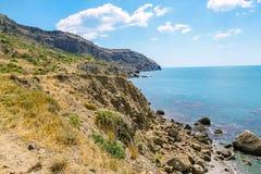 Sea and Mountains landscape at Cape Meganom, the east coast of the peninsula of Crimea. Beautiful nature, Colorful background. stock photos