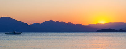 Sea and mountains at sunset Royalty Free Stock Photo