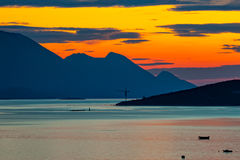 Sea and Mountains at sunset - silhouette. Royalty Free Stock Photos