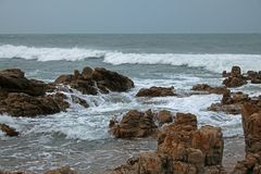 Sea moving through rugged rocks. Royalty Free Stock Images