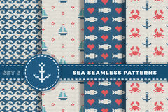 Sea and nautical backgrounds in white, turquoise, red and dark blue colors. Sea theme. Set seamless patterns collection. Woolen kn. Itted texture. Vector Stock Photography