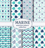 Sea and nautical seamless patterns set. Set of marine and nautical backgrounds in navy blue, turquoise and white colors. Sea theme. Cute seamless patterns Royalty Free Stock Photography
