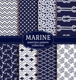 Sea and nautical seamless patterns set. Set of marine and nautical backgrounds in navy blue and white colors. Sea theme. Seamless patterns collection. Vector Royalty Free Stock Photography