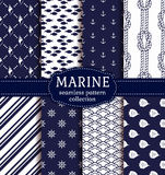 Sea and nautical seamless patterns set. Set of marine and nautical backgrounds in navy blue and white colors. Sea theme. Elegant seamless patterns collection Stock Images