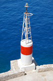 Sea Navigation Beacon Tower. On a Deep Blue Sea Background Stock Image