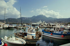 The sea. Near the sea, yachts, boats, sea, in the daytime, in the background the mountains, blue sky, cloud Royalty Free Stock Photography