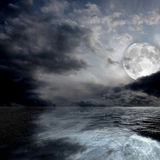 The sea by night. Image of a sea by night with the full moon Stock Photos