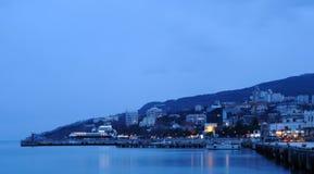 The sea and night city Royalty Free Stock Photos