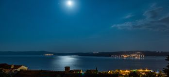 Sea at night. Nice sea at night with stars and city lights royalty free stock photography