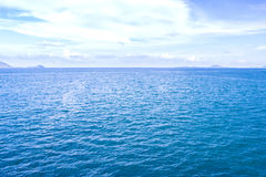 Sea Ocean Blue With Surface Calm  And Blue Sky Background Stock Photos