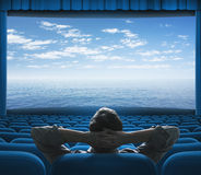 Sea or ocean on cinema screen. And man watching Royalty Free Stock Images