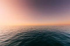 Sea Or Ocean And Colorful Sunset Or Sunrise Sky Background. Sea Or Ocean And Colorful Sunset Or Sunrise Clear Sky Background Royalty Free Stock Photos