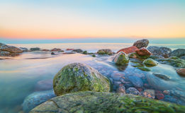 Sea, ocean, shore, coast, beach, stones, shape, long exposure, blurred, wave, water, calm, smooth, spacious, evening, sunset, morn Stock Photos