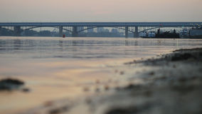Sea, ocean sunset with bridge on background. Royalty Free Stock Image