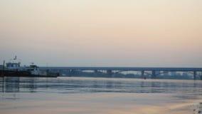 Sea, ocean sunset with bridge on background. Royalty Free Stock Photo