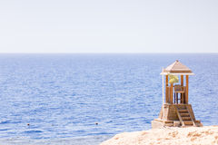 Sea or ocean view from shore with lifeguard post Royalty Free Stock Photo