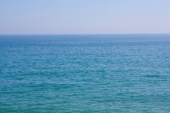 Sea. Ocean. Water. Background from the blue sea and the sky which merge among themselves on horizon Royalty Free Stock Photography