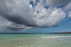 Sea or ocean water with blue sky and dramatic clouds Royalty Free Stock Photography