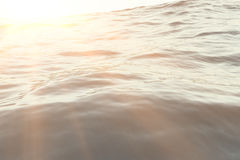 Sea, ocean wave close-up sunset, low angle view, cross processing effect. Hard focus with selective focus. 3d rendering Stock Image