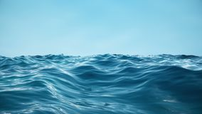 Sea or ocean, waves close-up view. Blue waves sea water. Blue crystal clear water. One can see the sandy seabed. Sea