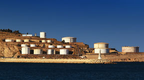 Sea with oil tanks Stock Images