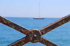 The sea from the old metal fence Stock Image