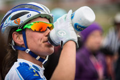 Sea Otter Classic Bike Festival - Short Track - Katerina Nash. Katerina Nash takes a drink after racing Short Track Cross Country racing at the 2014 Sea Otter Stock Images