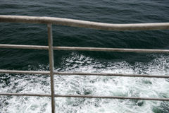 Sea over the fence Royalty Free Stock Images