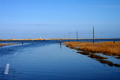 Sea over road. The causeway to Lindisfarne with the tide coming in flooding the road Royalty Free Stock Photo
