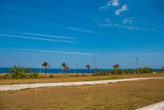 Sea and palm trees near the fortress. Havana. Cuba royalty free stock images