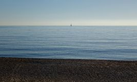 Sea panorama view with a lonely boat. In the distance Stock Photography