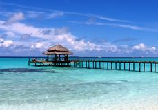 Sea Paradise of Maldives. Maldivian sky with one overwater on a blue sea Royalty Free Stock Images