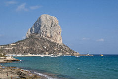 By the sea. Peñon de Ifach is a large rock in the Mediterranean Sea. Specifically in the Costa Blanca, Spain Stock Images