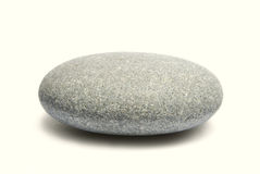 Sea pebble. On a white background royalty free stock images